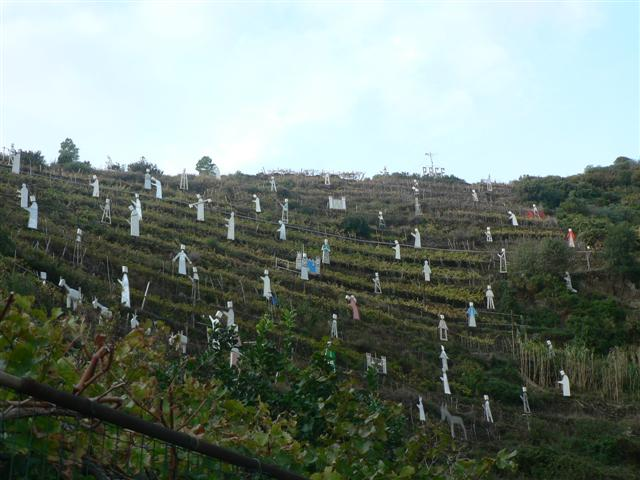 Hillside with wooden figures