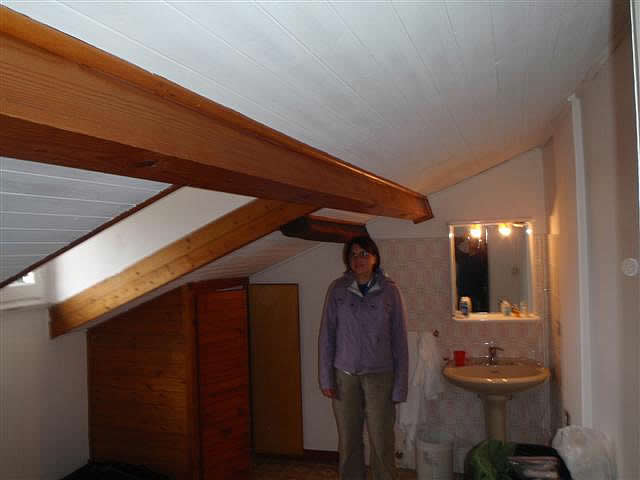 Cathy in low-ceiling room