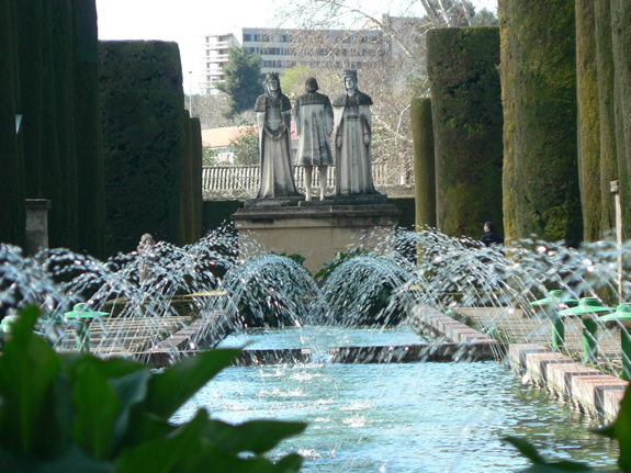 Fountains and statues in greenery
