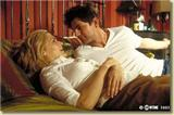 Lindsay and Brian on a bed